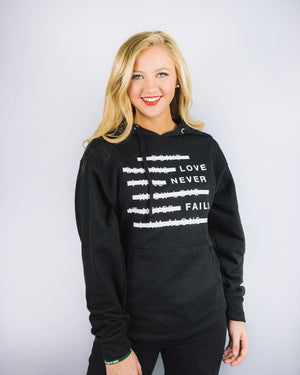 Love Never Fails Pullover Unisex Hooded Sweatshirts
