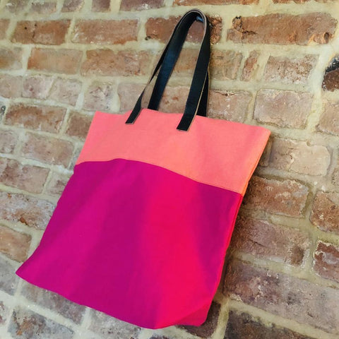 Bright handmade canvas shopper bag in orange & fuchsia with comfortable leather handle - hanging