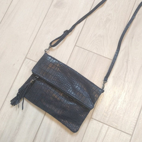 Crocodile hide effect foldover Italian leather clutch bag in navy with a strap