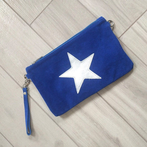 Italian suede leather clutch bag with shiny metallic leather star in blue