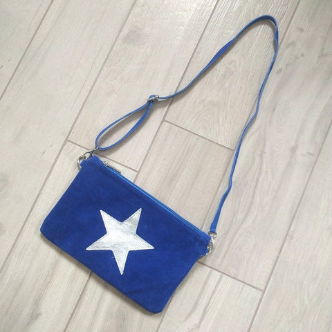 Italian suede leather clutch bag with shiny metallic leather star in blue with long strap