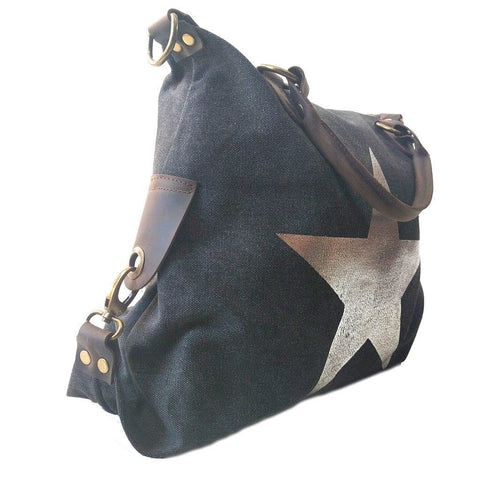 Vintage look canvas and genuine leather bag with shiny metallic star in black with handles and a detachable long strap