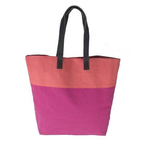 Bright handmade canvas shopper bag in orange & fuchsia with comfortable leather handle