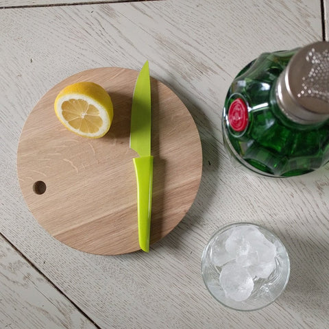 A beautifully crafted circular oak cutting or serving board by blomus with gin & tonic