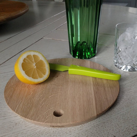 A beautifully crafted circular oak cutting or serving board by blomus with cut lemon