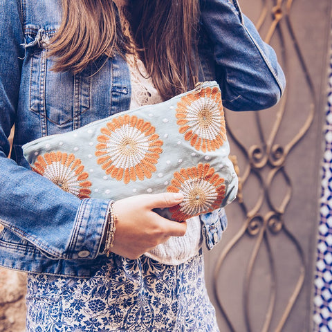 Soft canvas travel pouch in blue Lamu pattern with model