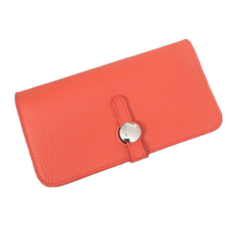 Genuine Italian leather travel wallet or purse with multi compartments in bright orange on white background