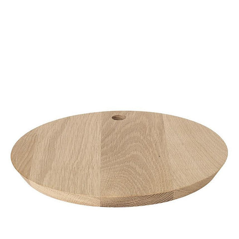 A beautifully crafted circular oak cutting or serving board by blomus