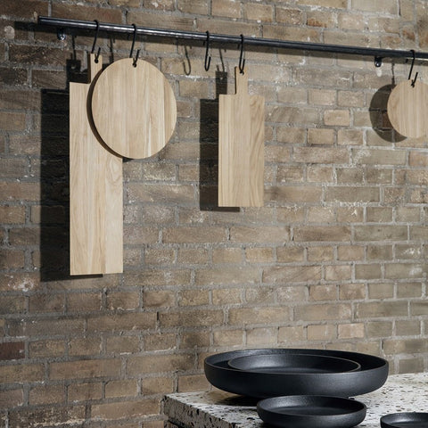 A beautifully crafted circular oak cutting or serving board by blomus - hanging
