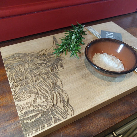 Scottish oak cutting or serving board with engraved highland cow decoration