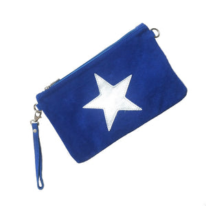Italian suede leather clutch bag with shiny metallic leather star in blue on a white background