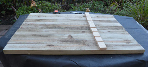 Attach wooden blocks to posts of grow box