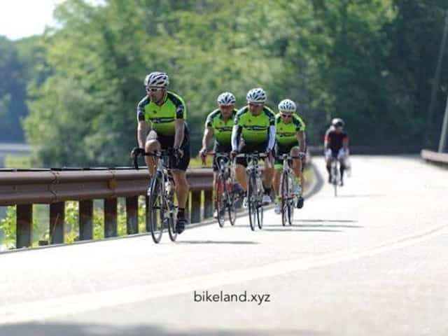 Cyclists Riding in a group wearing custom bike clothing from Bikeland.