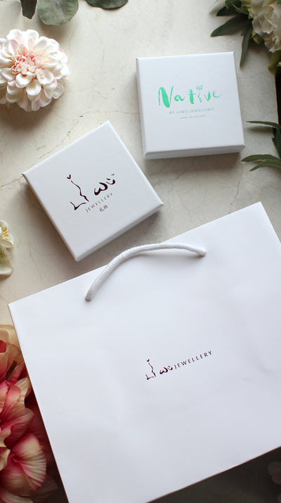 white bag and white box with liwu jewellery in hot foil and white box with native in green foil