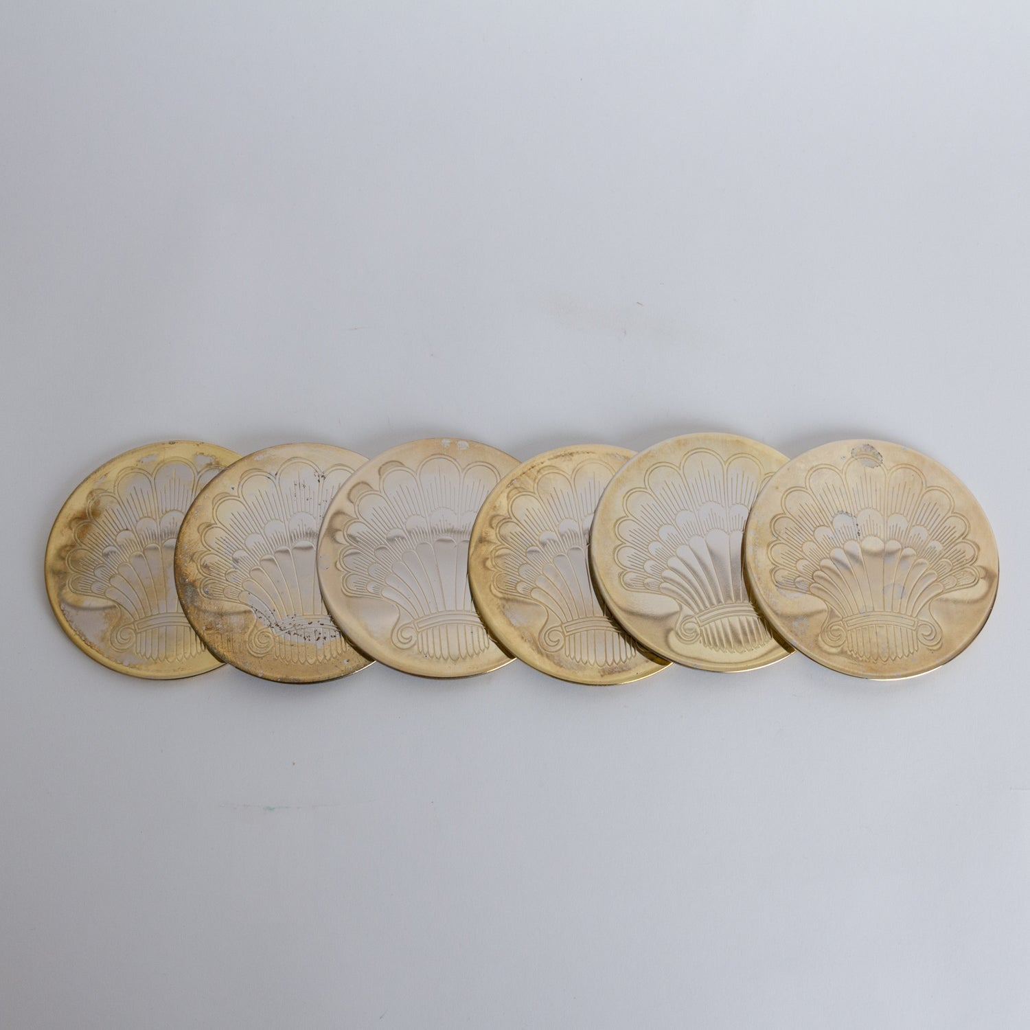 Etched Shell Coasters in Brass