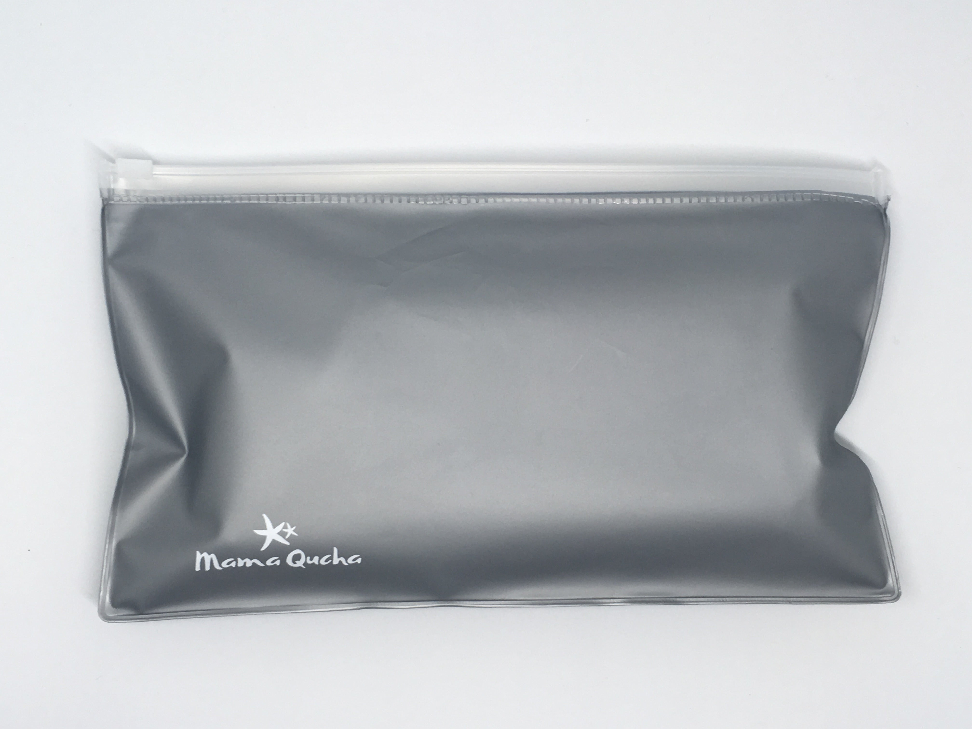 The Mama Qucha small zip lock wet bag that fits inside baby change clutch