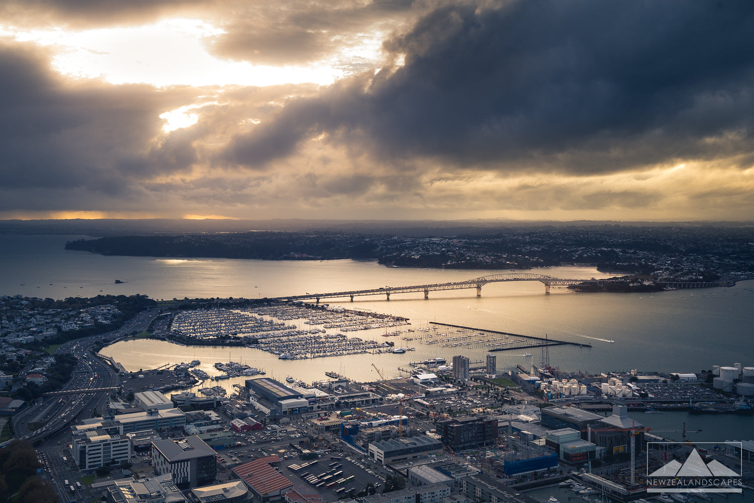 Auckland Harbour Bridge with sun breaking through clouds print and canvas