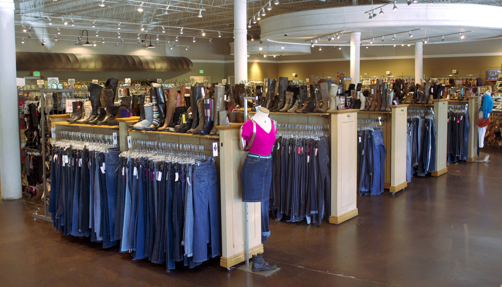 consignment store display women's jeans women's boots