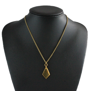 African handmade brass necklace on black display