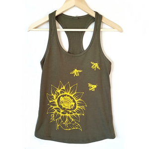 Sunflower & Honey Bees Women's Tank. This will be your new favorite shirt! Soft, modern and original. Great for any outdoor activity, be ready to stand out of the crowd.  Cotton/poly blend material, laundered, design in gold yellow ink. Form fitted racerback.  Sale, only a few sizes left!!!
