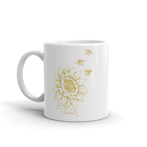 Decker Honeybees Sunflower Mug. Whether you're drinking your morning coffee, your evening tea, or something in between – this mug's for you! It's sturdy and glossy with beuatiful original art that'll withstand the microwave and dishwasher. Ceramic. Dishwasher and microwave safe. White and glossy