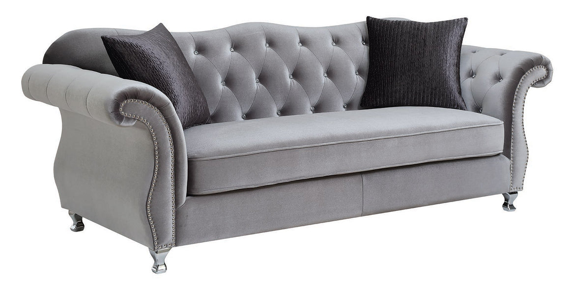 velvet like gray tufed sofa