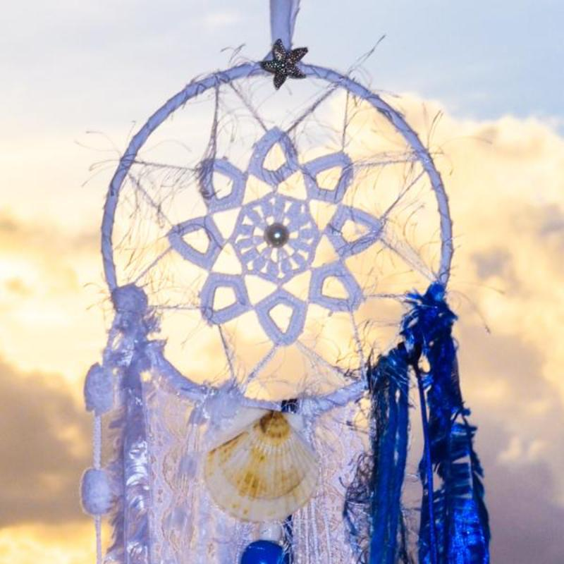 Handmade boho dream catcher by visionary artisan Kylee Joy in beautiful deep blue and white tones.