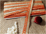 Orange and gold beaded trim