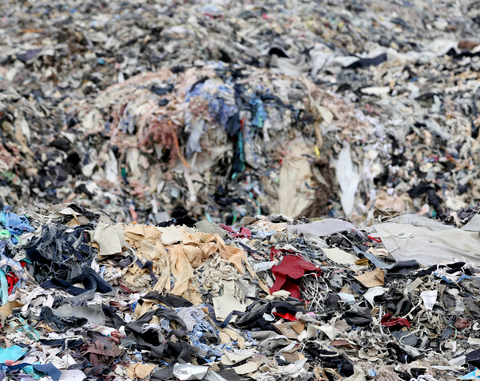 landfill filled with discarded clothing
