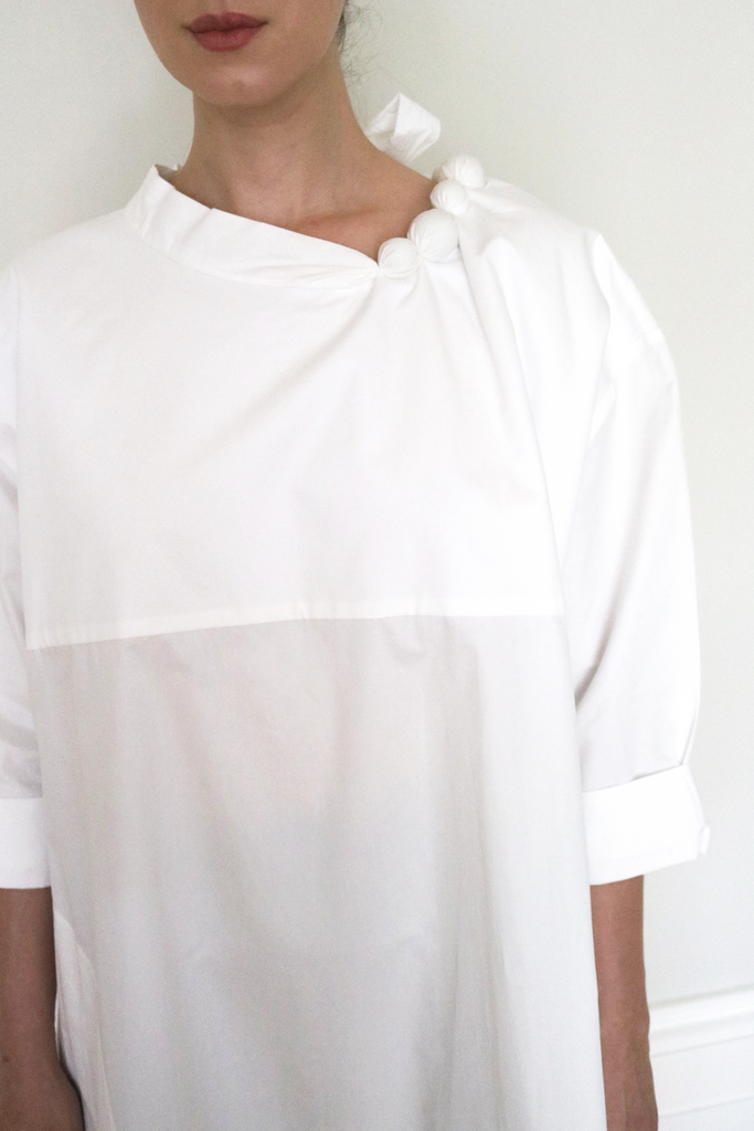 Oversized long tunic shirt with ball neck detailing