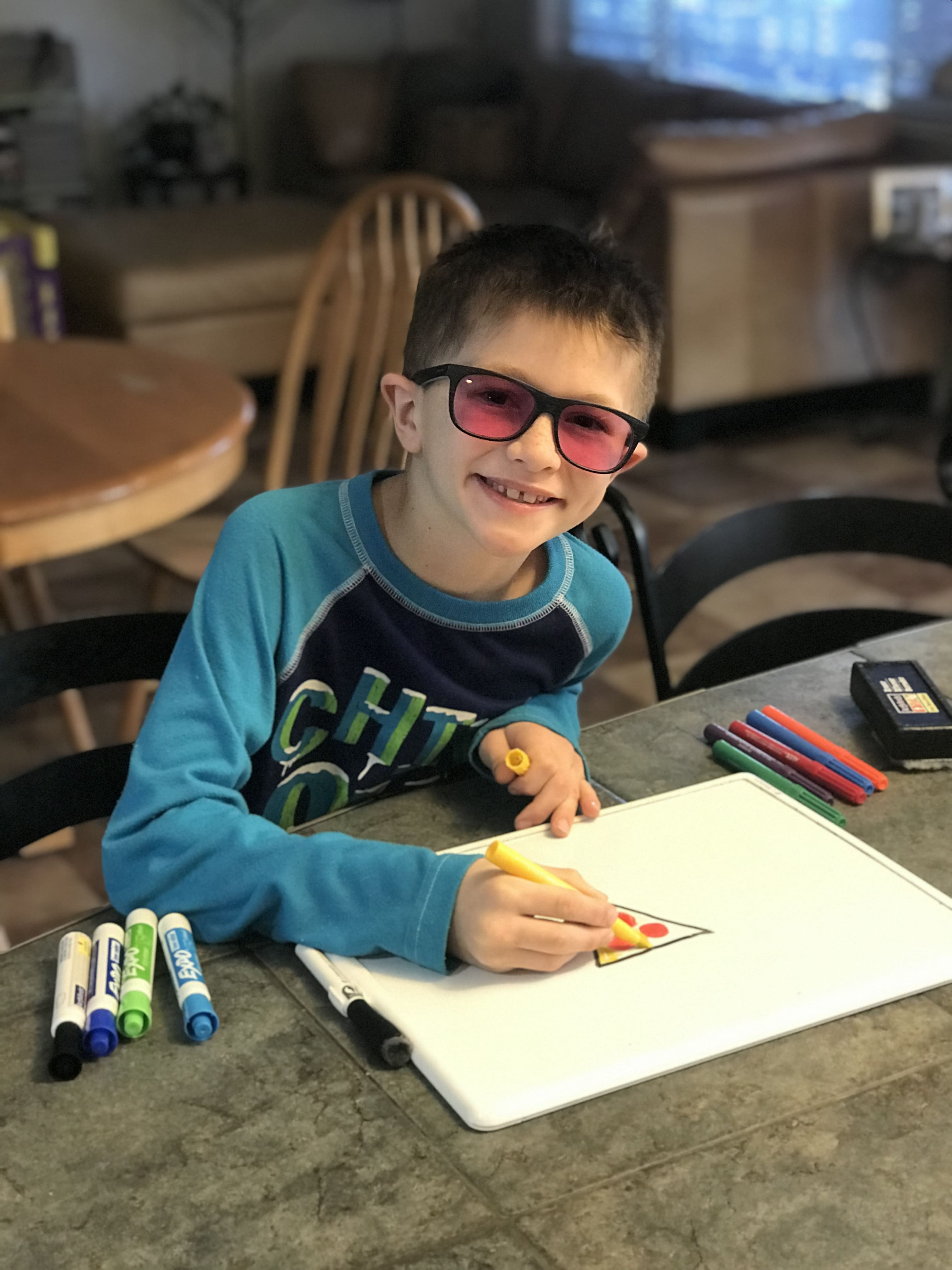 young color blind boy smiling with glasses