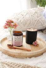 Cacoa tea by The Husk Mill and candle by Scented Purpose sitting on wooden tray on bed