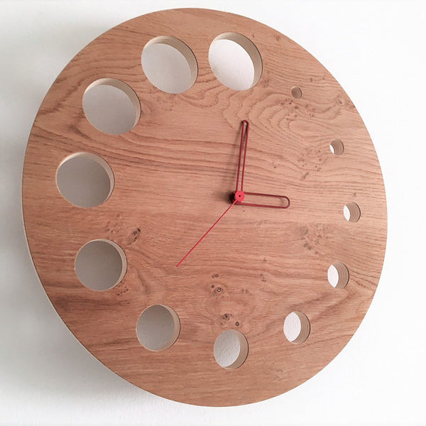 minimaproject flying saucer wall clock oak wood with red hollow arms | ikonitaly