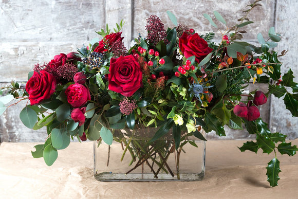 Winter Red Roses with mixed seasonal foliage and berries (Vase included)