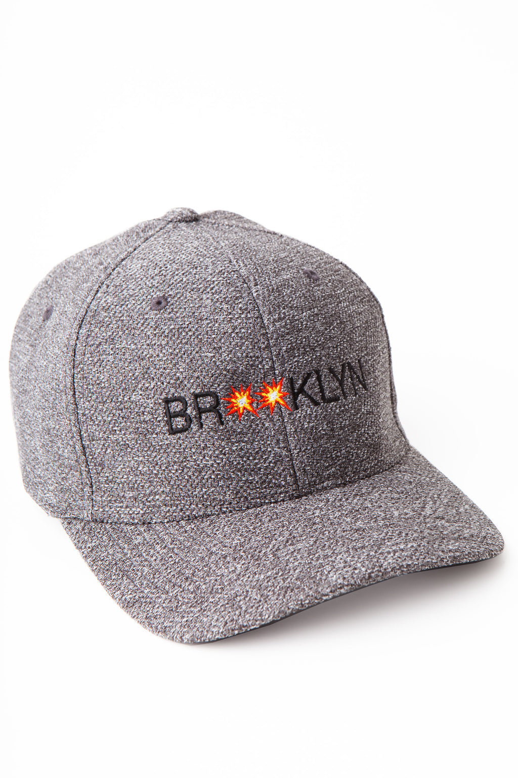 Dark grey heathered baseball cap with the words Brooklyn in black embroidered across the front.  The two o's of Brooklyn are small explosions.