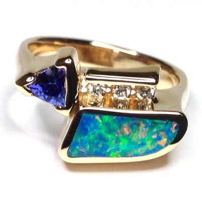 SUPERIOR QUALITY OPAL INLAID TRILLION CUT TANZANITE AND .08ctw DIAMOND RING