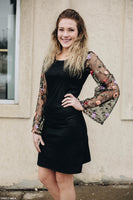 Black sheath dress with floral lace sleeves
