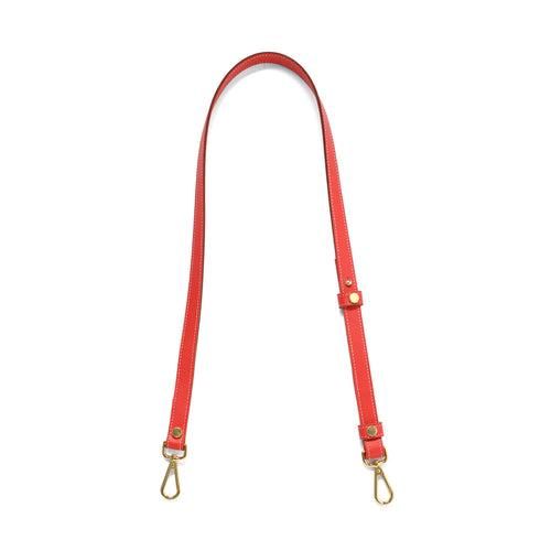 Coral leather cross body strap with gold tone clasps