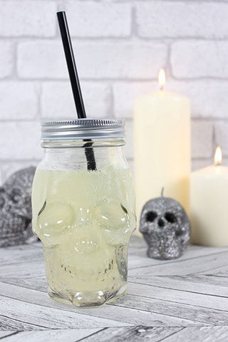 Skull head novelty clear glass drinking jar with silver screw on lid and black straw.