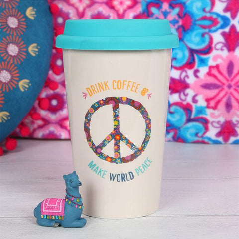 "Thermal travel coffee mug with ""Drink Coffee Make World Peace"" slogan and floral Peace symbol."