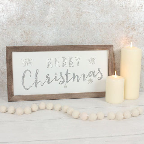 """Merry Christmas"" rustic wooden framed silver glitter wall art panel. Approx. size: 40cm x 20cm x 1cm"