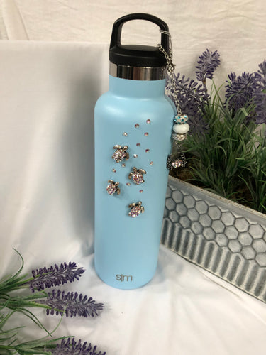 lt blue insulated water bottle with turtle charms