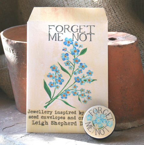 Seed Envelope Draughts Piece Brooch - Forget Me Not