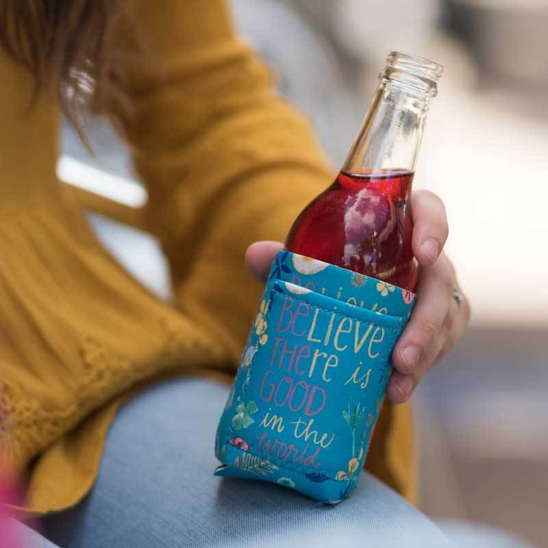 "Inspirational sentiment, ""Believe There Is Good In The World"" and fun artwork makes this pocketed drink sleeve, from the Simple Inspirations Collection, a practical, inspirational & fun treat for yourself or a friend."