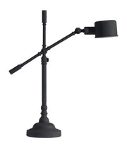 Turn Table Lamp From the Lighting Collection in Metal with In-line Switch. Turn Table Lamps bulb type is Type A19 with Max bulb watt at 40W with socket size E26