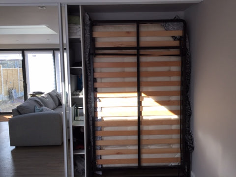 Drop-Down bed hidden away behind sliding doors
