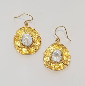 Pearl centered gold circle earrings