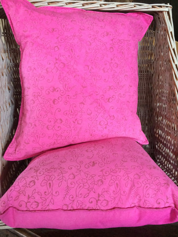 Bright pink hand printed cushion