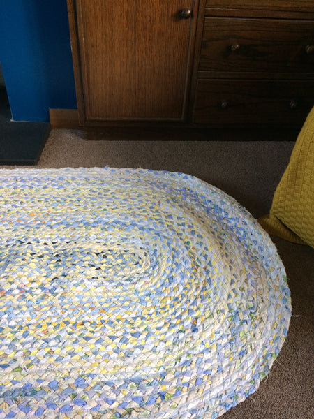 Blue and yellow oval plaited rug