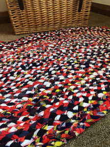 Red, white, blue and yellow oval rug